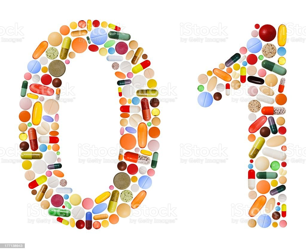 Numbers 0 and 1 made of various colorful pills stock photo