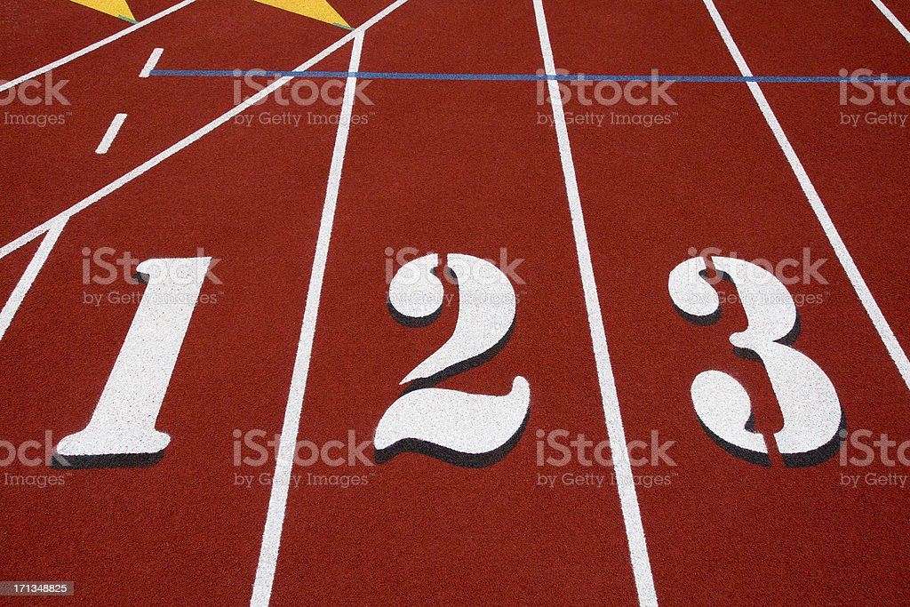 Numbers 1,2,3 on red running track. royalty-free stock photo