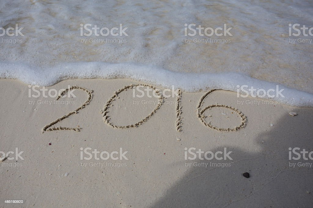 Numbers 2016 on beach - concept holiday background stock photo