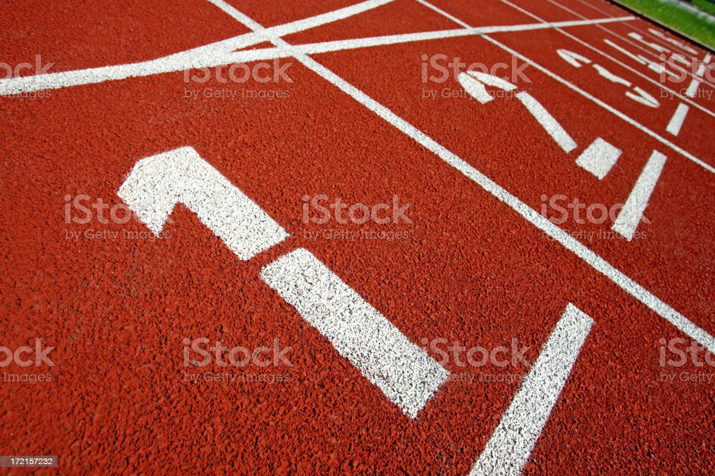 Numbers of the starting line up at a track field royalty-free stock photo
