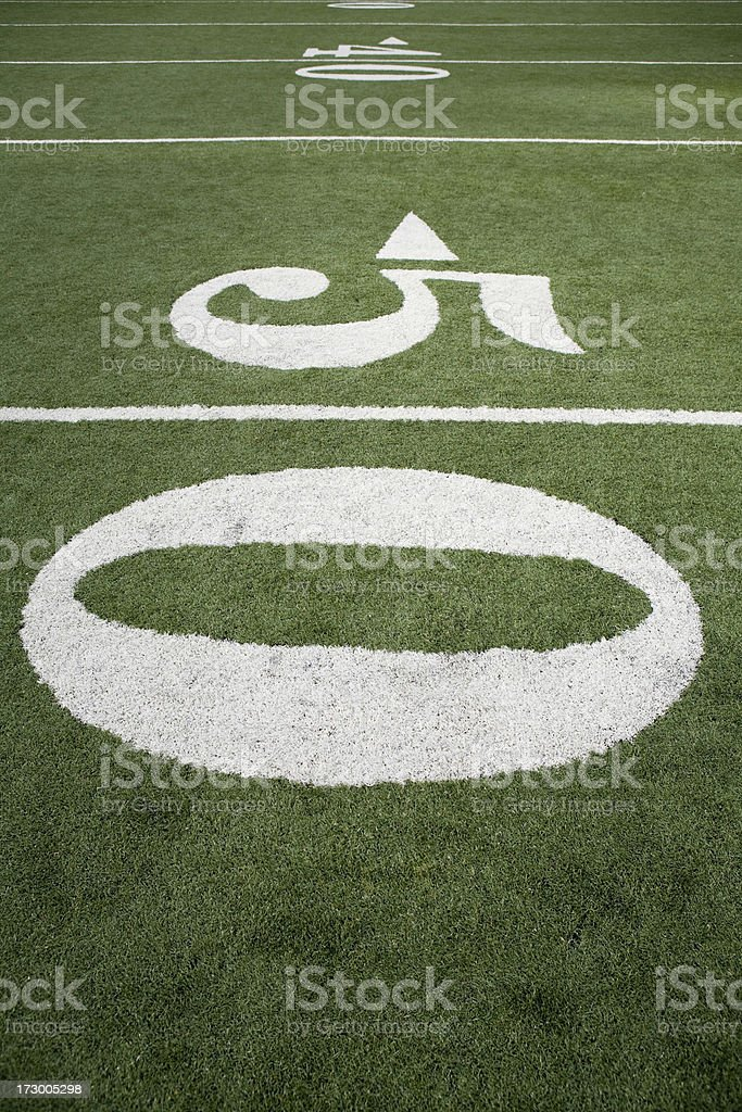Numbers on a football field 50 yard Line royalty-free stock photo
