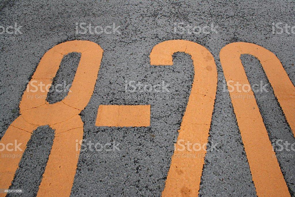 Numbers on asphalt royalty-free stock photo
