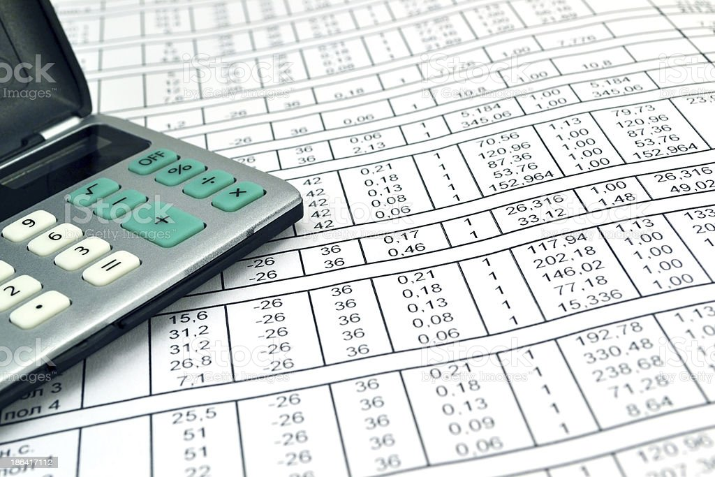 Numbers on paper and calculator royalty-free stock photo