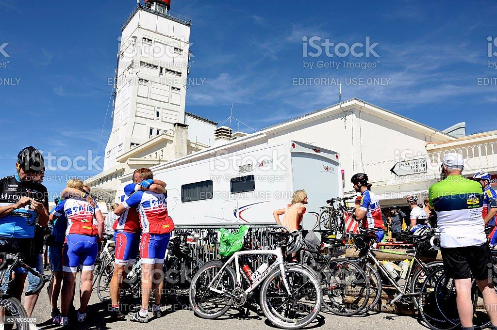 Numerous cyclists who climbed Mount Ventoux bike celebrate their stock photo