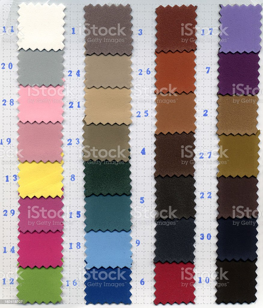 Numerous multicolor fabric swatches laid out royalty-free stock photo