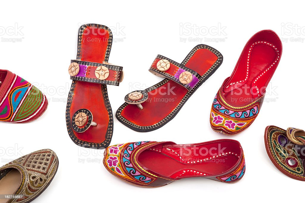 Numerous multicolored handmade Indian shoes. stock photo