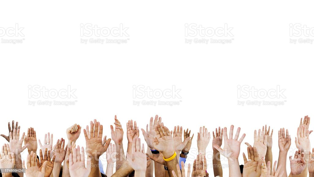 Numerous raised hands against white background stock photo