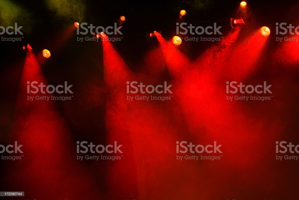 Numerous Red Stage Lights with Fog and a Dark Background royalty-free stock photo