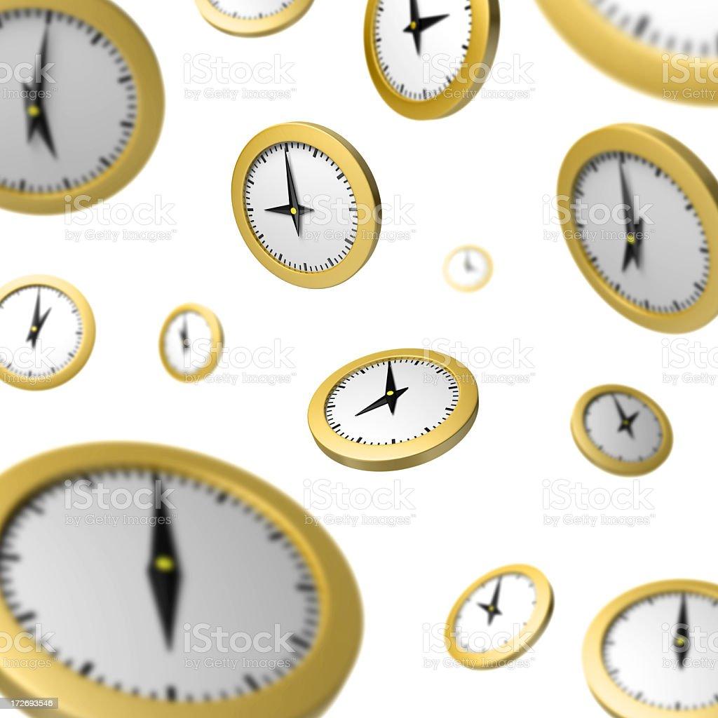 Numerous yellow free falling clocks on a white background royalty-free stock photo
