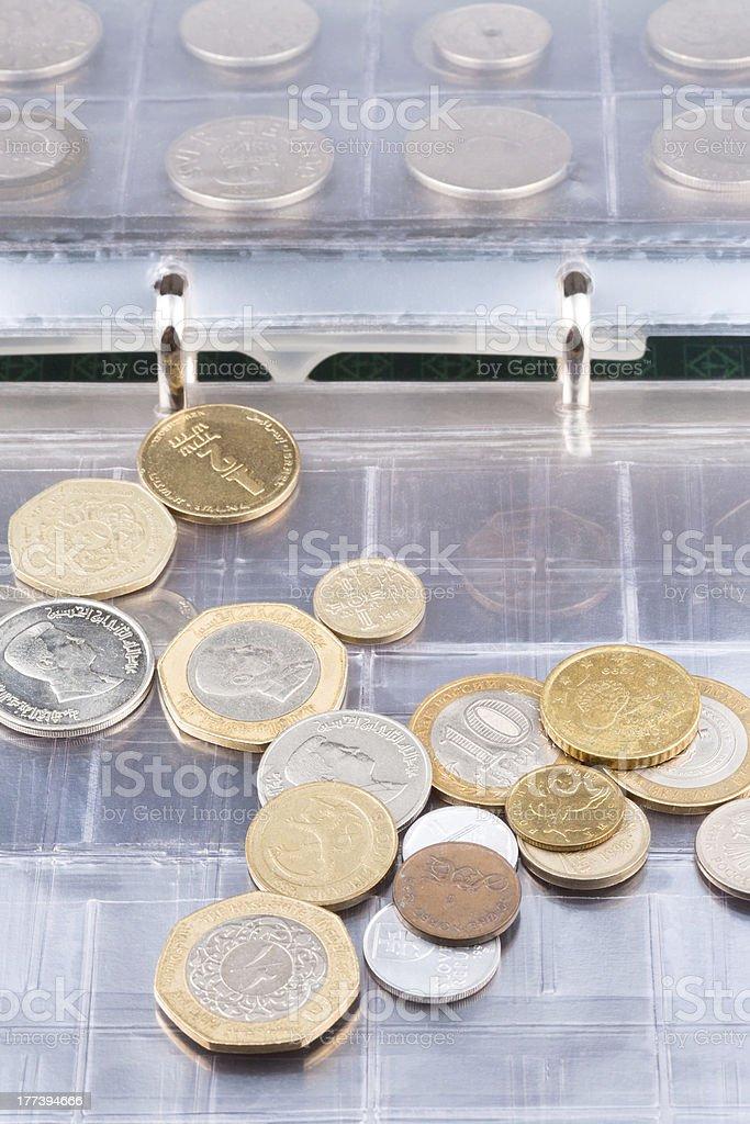 numismatics album with different coins stock photo