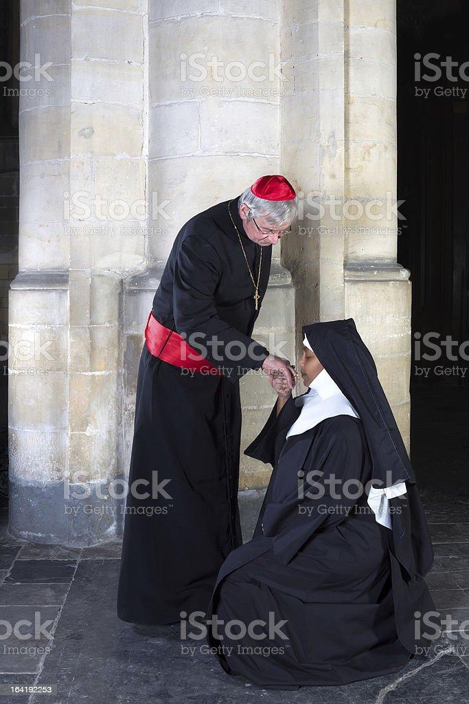 Nun kissing ring cardinal royalty-free stock photo