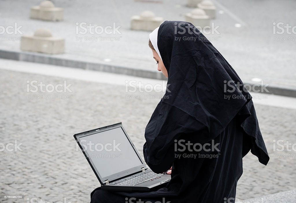 Nun - modern life stock photo