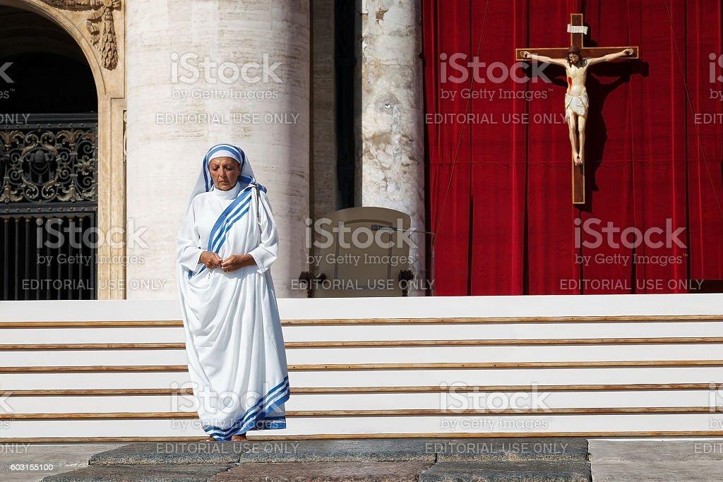 Nun praying and crucified stock photo