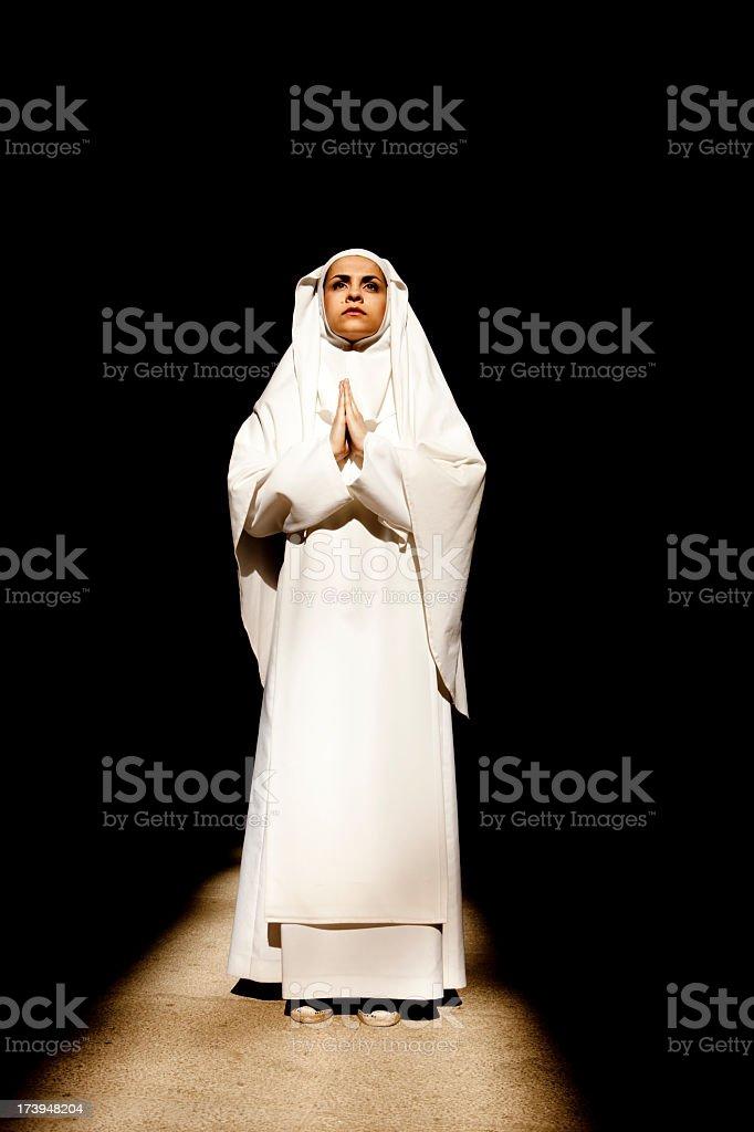 Nun Praying royalty-free stock photo