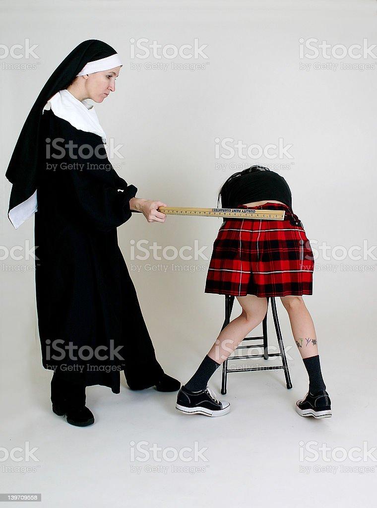 Nun spanking a School Girl royalty-free stock photo