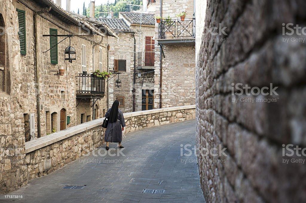 Nun walking alone stock photo