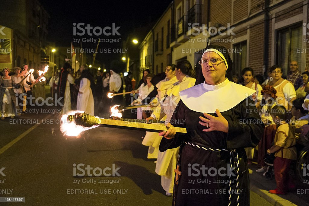 Nun with a torch stock photo