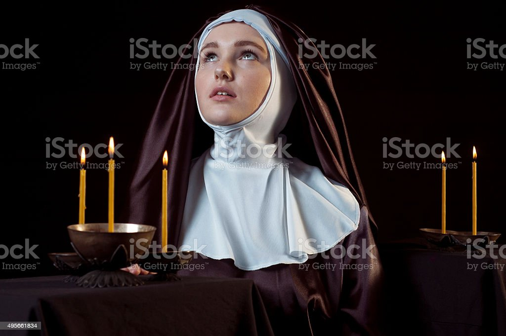 Nun with candles. stock photo
