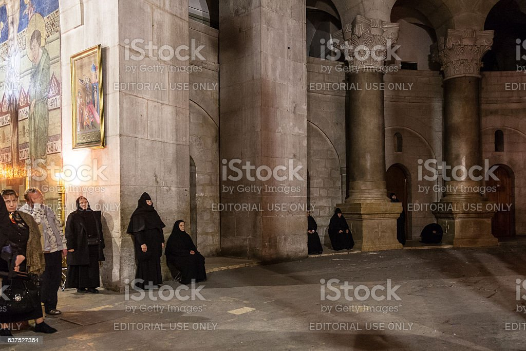 Nuns meditate in Holy Sepulchre Church stock photo