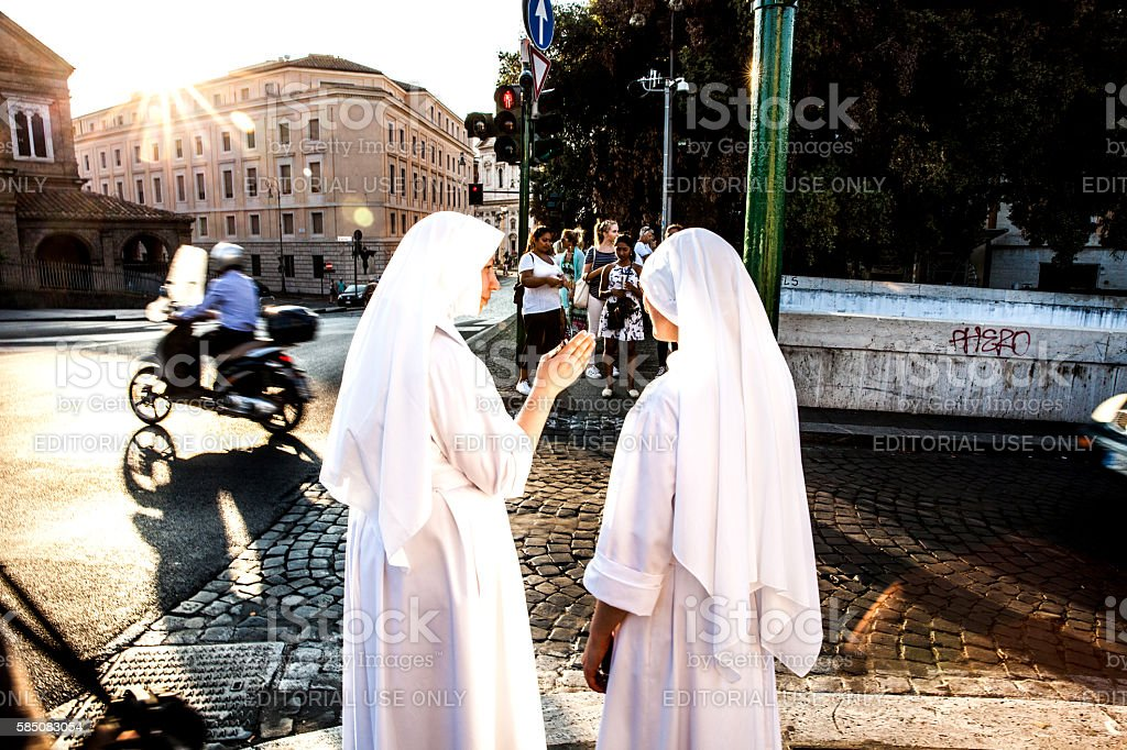 Nuns walking in Central Rome, close to Vatican City stock photo