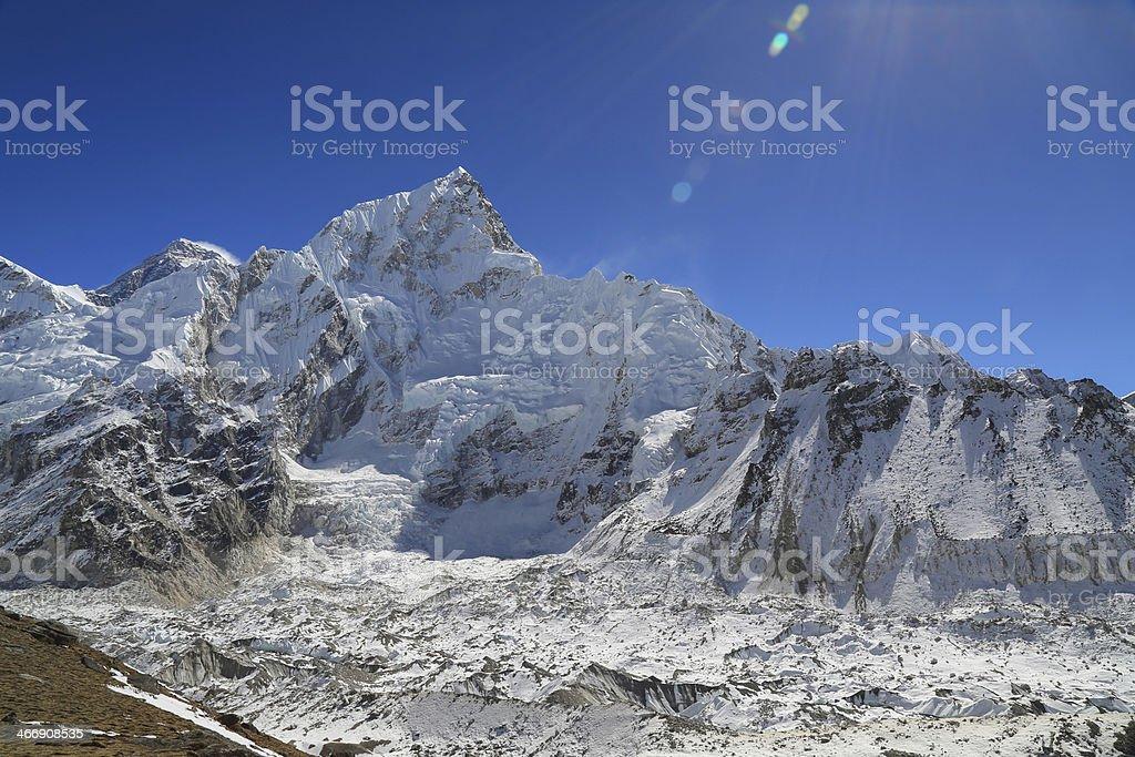 nuptse summit beside of everest from kallapather stock photo