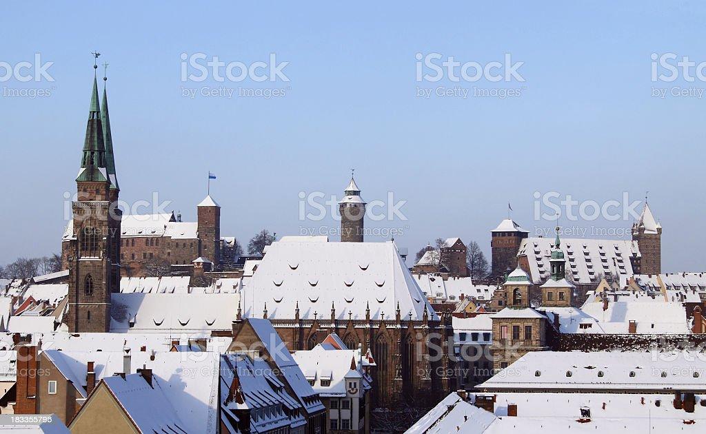 Nuremberg Sebaldus church with castle - winter stock photo