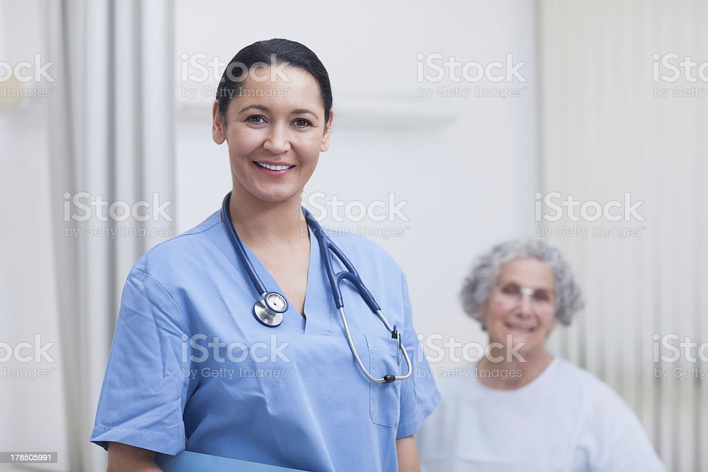Nurse and a patient looking at camera royalty-free stock photo