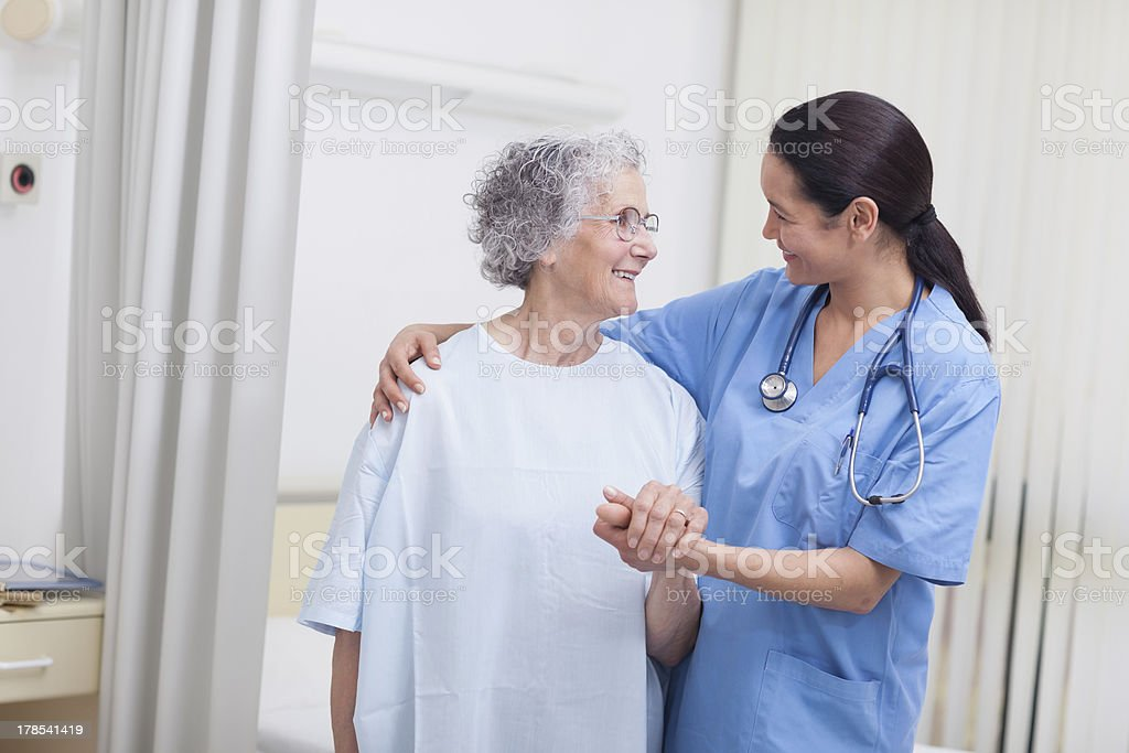 Nurse and a patient standing royalty-free stock photo