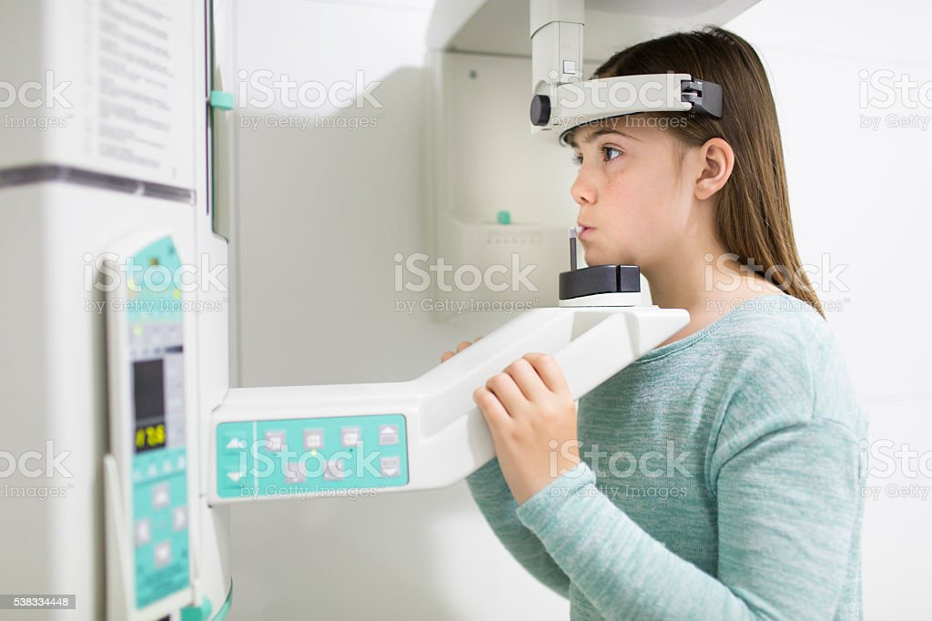 Nurse and child patient in x-ray machine stock photo