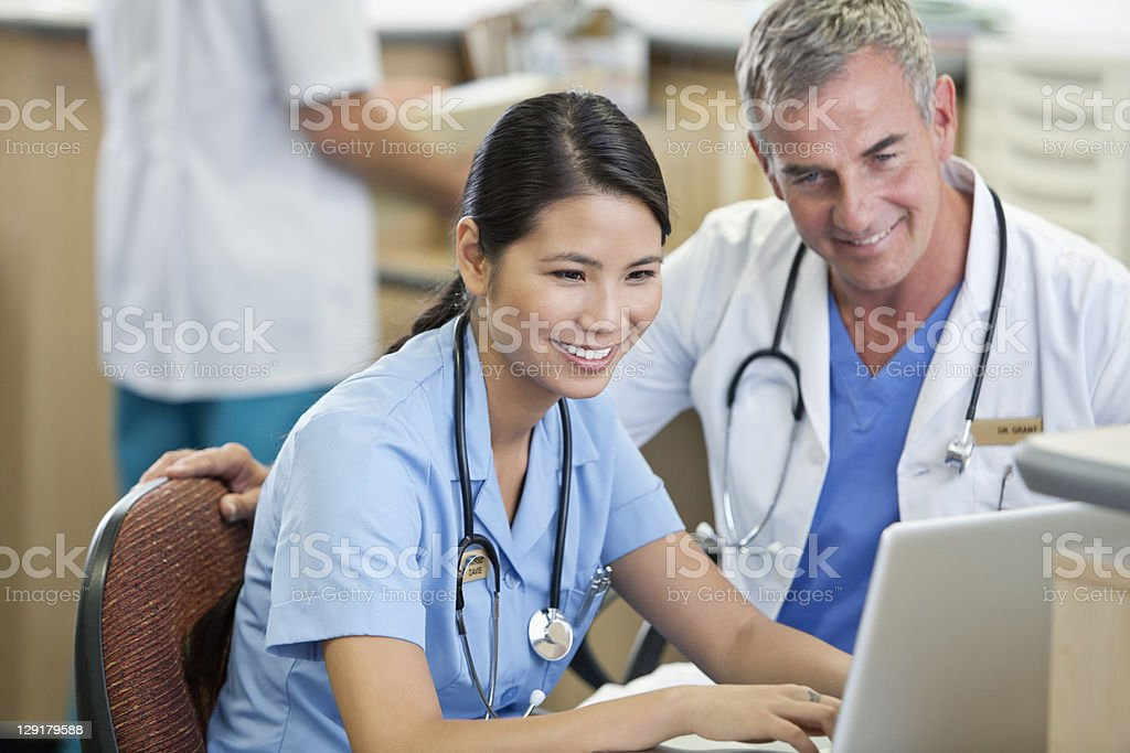 Nurse and doctor using laptop royalty-free stock photo