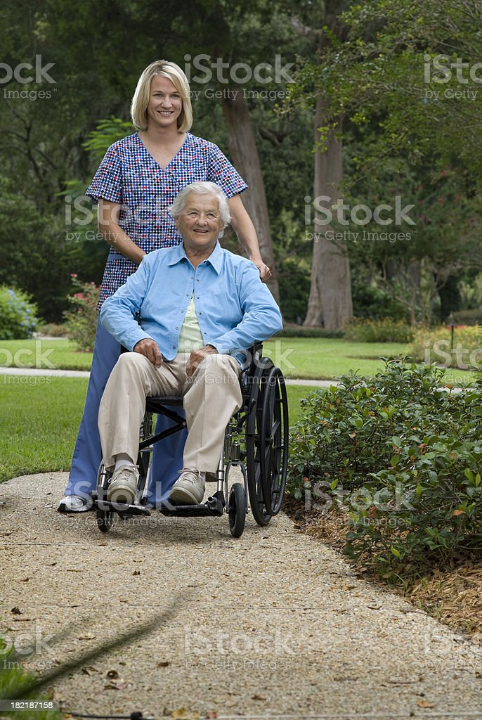 Nurse and elderly woman on a walk. royalty-free stock photo