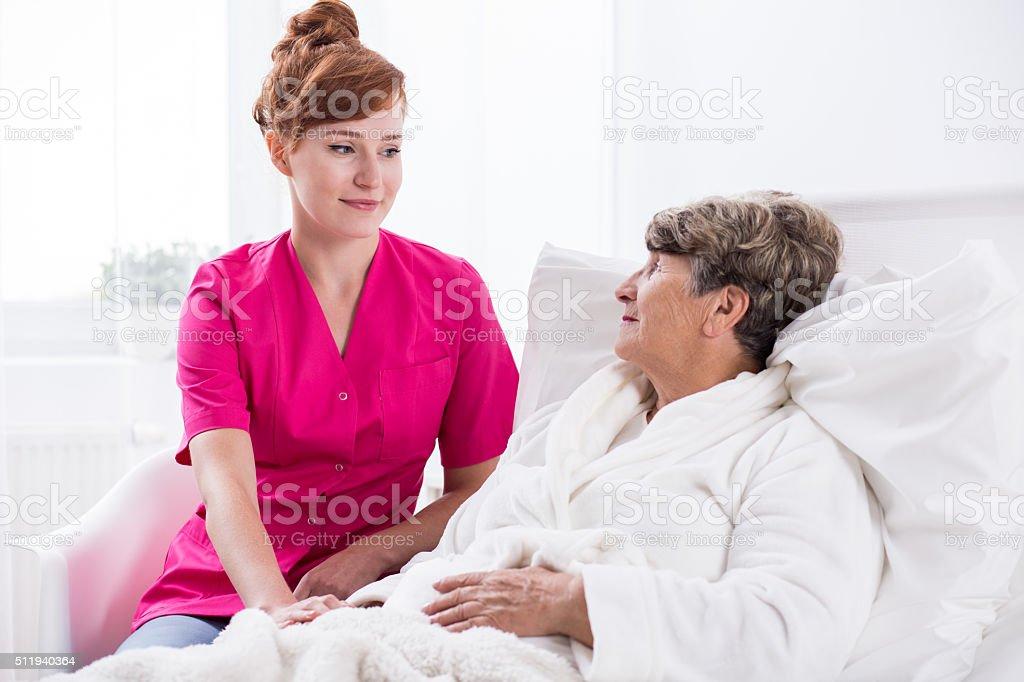 Nurse and geriatric ward patient stock photo