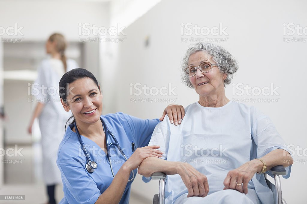 Nurse and patient smiling royalty-free stock photo