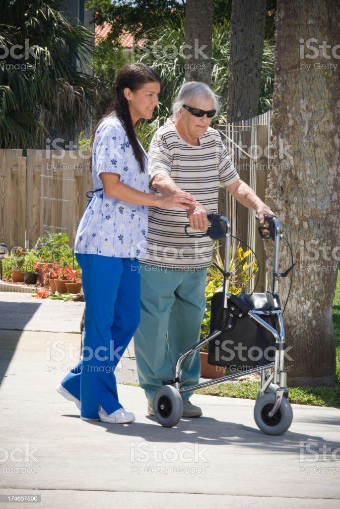 Nurse and senior citizen stock photo