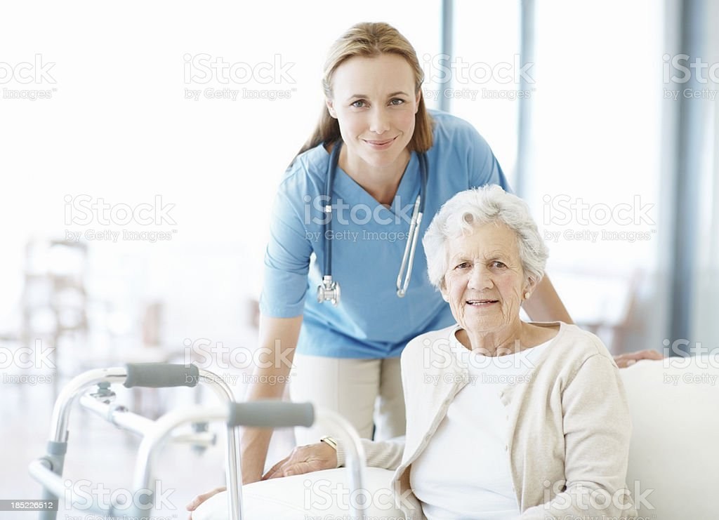 Nurse and senior patient with walker royalty-free stock photo