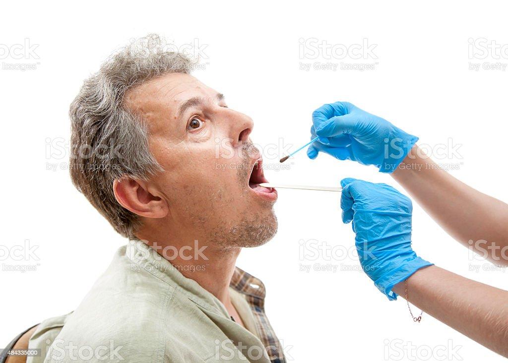 Nurse applying  iodine stock photo