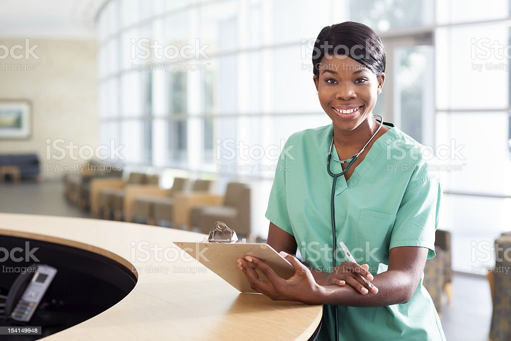 Nurse at work station stock photo