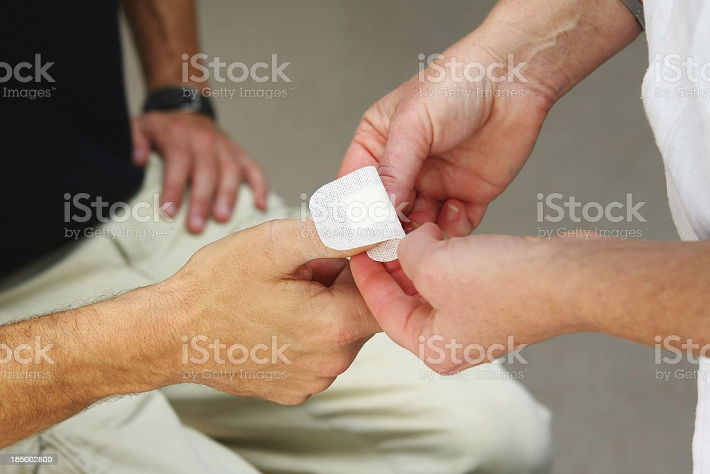 Nurse at work...changing bandage to a wounded patient royalty-free stock photo