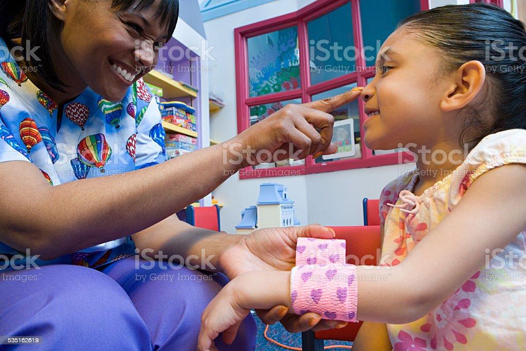 Nurse caring for girl stock photo