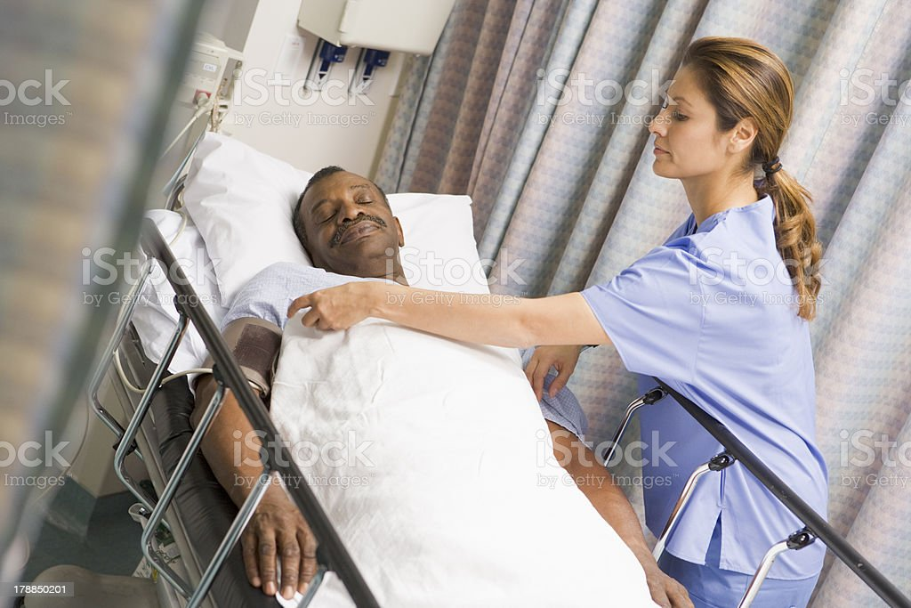 Nurse Caring For Patient stock photo