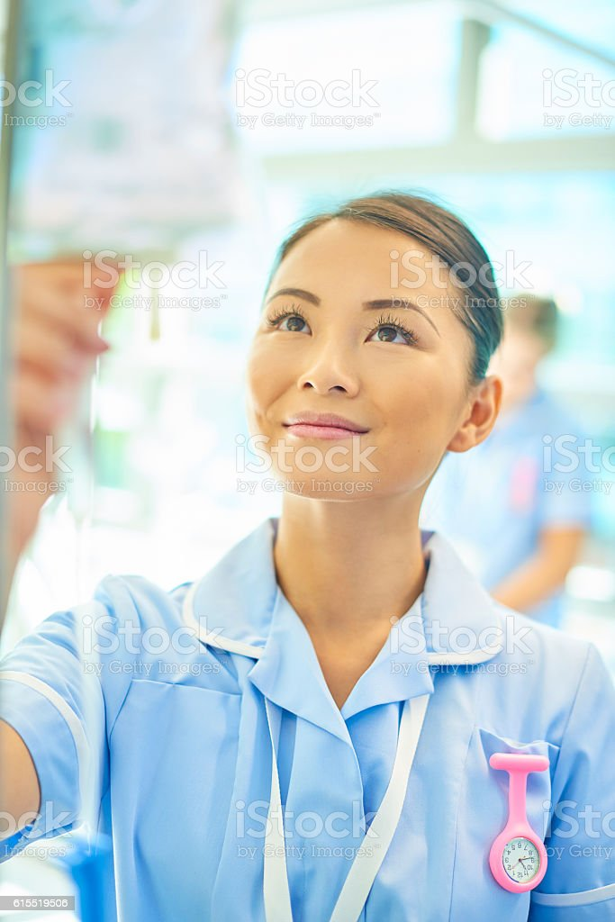 nurse checking drip stock photo