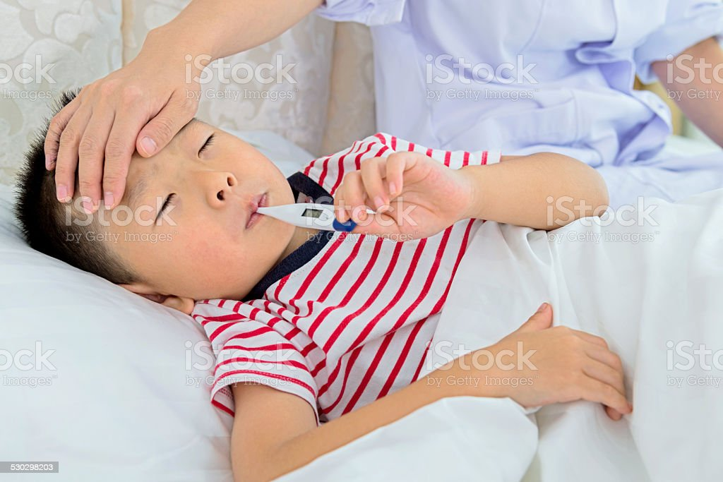 nurse checking fever stock photo