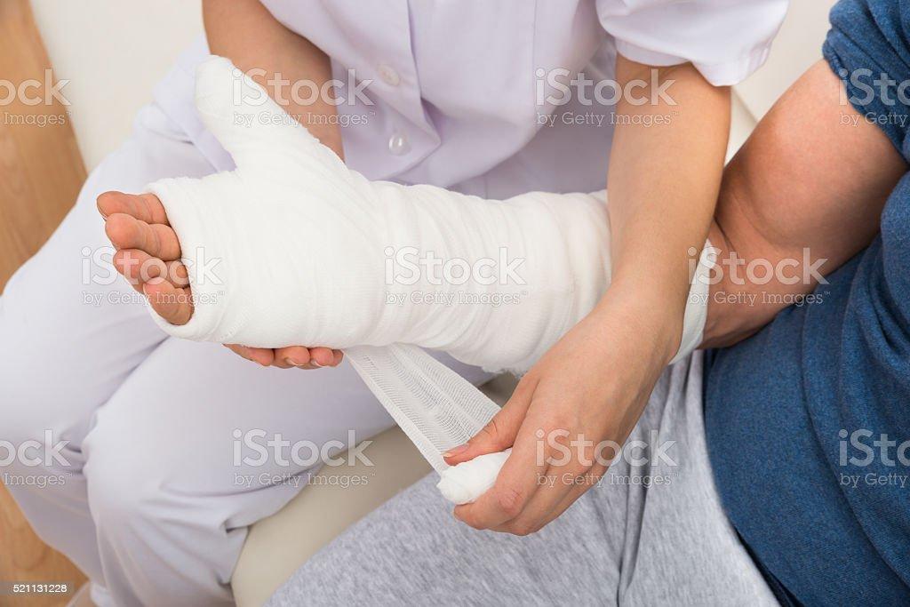 Nurse Dressing Patient's Hand stock photo