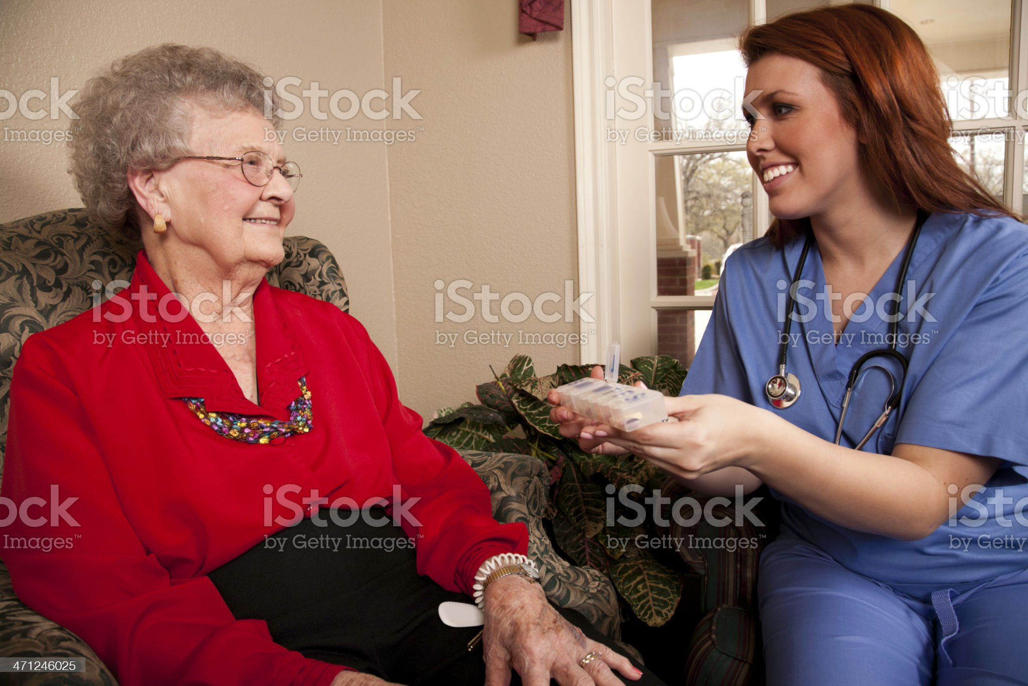 Nurse Explaining Daily Medication to Senior Adult Patient royalty-free stock photo