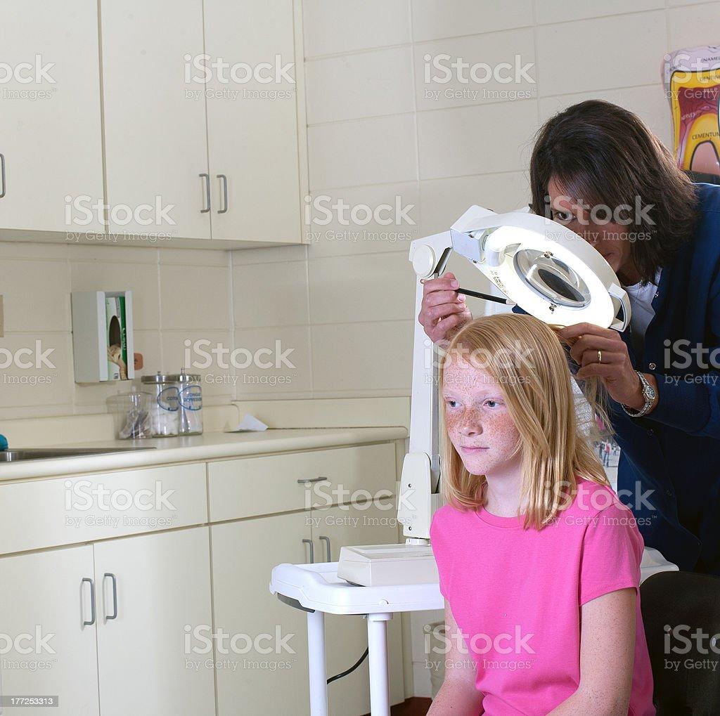 Nurse for head lice stock photo