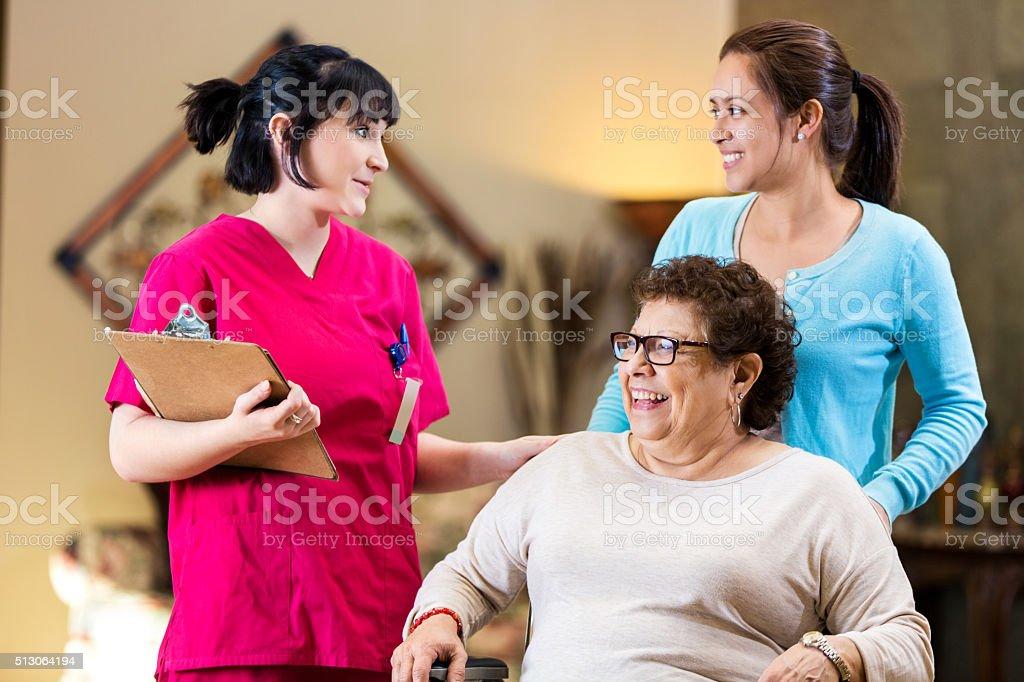 Nurse gives senior woman instructions as she leaves hospital stock photo