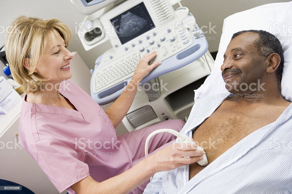Nurse Giving Patient An Ultra Sound royalty-free stock photo
