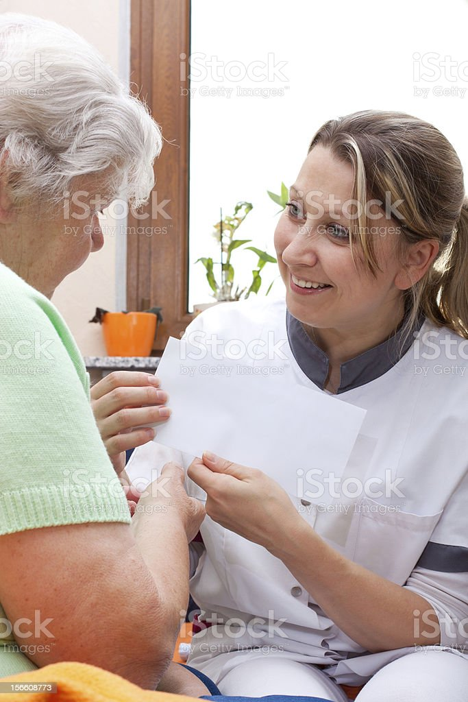 nurse handed patient an letter royalty-free stock photo
