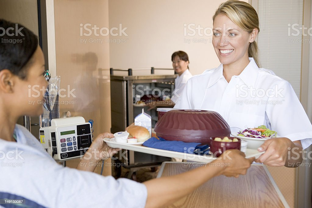 Nurse Handing Over Meal To Patient stock photo