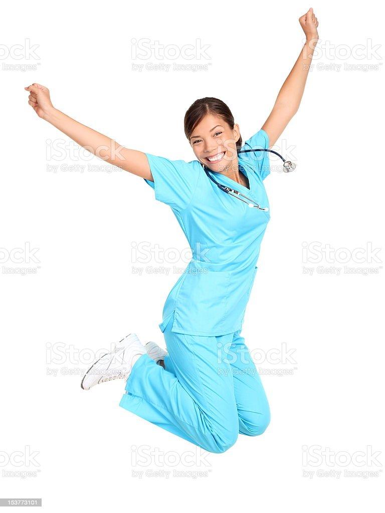 Nurse happy jumping stock photo